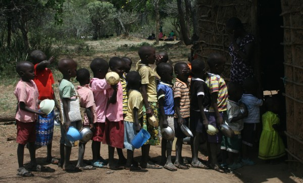 Children queuing up for a midday meal at Wasat